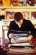 Man looking through records, Reckless secondhand record shop, Soho, London, 1998