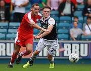 Chesterfield player Dan Gardner and Millwall player Ben Thompson race each other for the ball during the Sky Bet League 1 match between Millwall and Chesterfield at The Den, London, England on 29 August 2015. Photo by Bennett Dean.