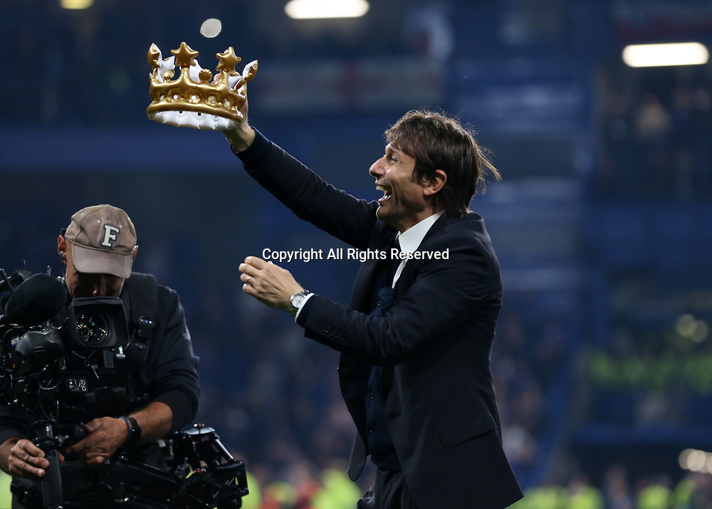 May 15th 2017, Stamford Bridge, London, England; EPL Premier League football, Chelsea FC versus Watford; Chelsea Manager Antonio Conte celebrates after full time with a blow up crown as Chelsea are 2016/17 Premier League Champions