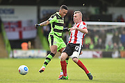 Lincoln City Midfielder, Harry Anderson (12) tackles Forest Green Rovers Midfielder, Keanu Marsh-Brown (7) during the Vanarama National League match between Forest Green Rovers and Lincoln City at the New Lawn, Forest Green, United Kingdom on 19 November 2016. Photo by Adam Rivers.