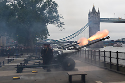 © Licensed to London News Pictures. 02/06/2016. LONDON, UK. Soldiers from the Honourable Artillery Company (HAC) fire a 62 round gun salute at The Tower of London, near Tower Bridge to mark the 63rd anniversary of the coronation of Great Britain's Queen Elizabeth II in 1953. A Royal Salute normally comprises 21 guns, but is increased to 41 if fired from a Royal Park or Residence and uniquely, at The Tower of London, a total of 62 rounds are fired on Royal anniversaries, including an additional 21 guns for the citizens of the City of London to show loyalty to the Monarch.  Photo credit: Vickie Flores/LNP