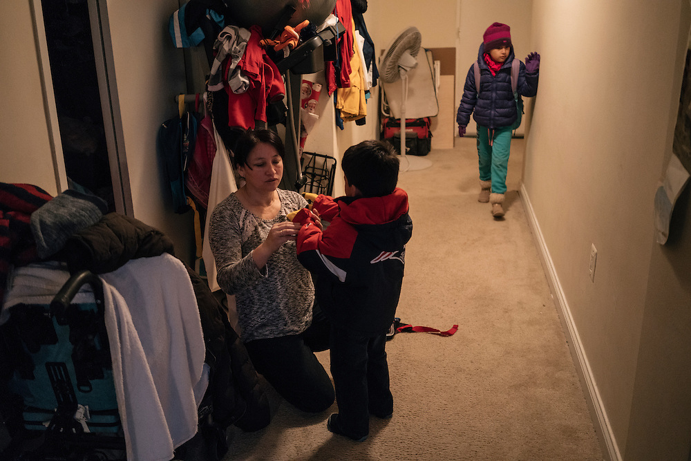 Eufronia Alba readies her daughter, Danna, 7, and son Nathan, 4, for school at her apartment in Arlington, Va. on Dec. 15, 2016. Alba and her husband, undocumented Bolivians, were in deportation proceedings but have requested cancellation of removal because Joshua, who is American-born, has cerebal palsy and depends on his parents for everything including bathing and feeding. CREDIT: Greg Kahn / GRAIN for the Wall Street Journal TRUMPLOOP