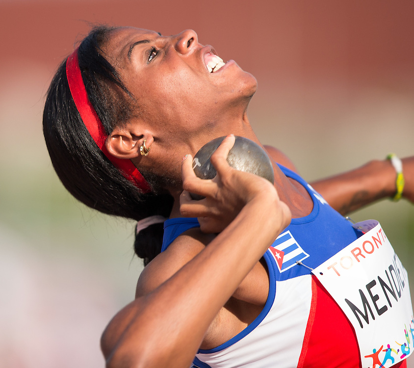 Yusleidys Mendieta of Cuba throws the shot put during the women's heptathlon competition at the 2015 Pan American Games at CIBC Athletics Stadium in Toronto, Canada, July 24,  2015.  AFP PHOTO/GEOFF ROBINS