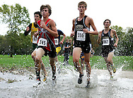 Jud Schneider (145) (So) of Monticello High School and Eric Thein (166) (Jr) of Tipton High School splash their way through the water at the Class 2A District Cross Country meet at the Jones County Fairground in Monticello on Thursday October 18, 2007. Thein placed second with a time of 17:07.07 and Schneider placed ninth with a time of 17:45.91.