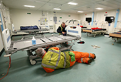 Final preparations are made by crew in the medical centre below deck ahead of sea trials this summer, for the Royal Navy's new aircraft carrier HMS Queen Elizabeth, at Rosyth Dockyard in Dunfermline.