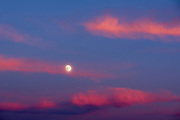 Full moon and clouds at sunset.