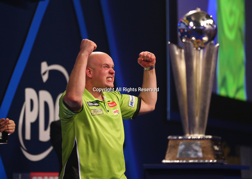 02.01.2017. Alexandra Palace, London, England. William Hill PDC World Darts Championship final  between top seeds Michael van Gerwen (1) and Gary Anderson (2). Michael van Gerwen celebrates winning the World Darts Final, beating Defending World Champion Gary Anderson 7 sets to 3, and prepares to receive the Trophy
