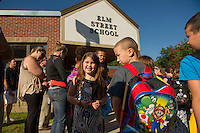Tessa is all smiles as she lines up for her first day back to school at Elm Street Elementary on Tuesday morning.  (Karen Bobotas/for the Laconia Daily Sun)