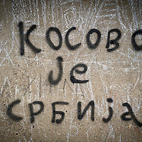 "North Mitrovica,  Kosovo 18 February 2011<br /> Graffiti in North Mitrovica. Translation: ""Kosovo is serbian"". <br /> Since the end of the Kosovo War of 1999 Mitrovica has been divided between an ethnic-Albanian-majority south and an ethnic-Serb-majority north. Its northern part is the de facto capital of the Serb enclave of North Kosovo.<br /> Photo: Ezequiel Scagnetti"