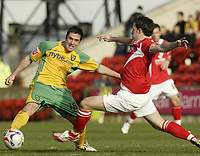 Photo: Aidan Ellis.<br /> Barnsley v Norwich City. Coca Cola Championship. 03/03/2007.<br /> Norwich's Mark Fotheringham (L) avoids the tackle from Barnsley's Sam Togwell