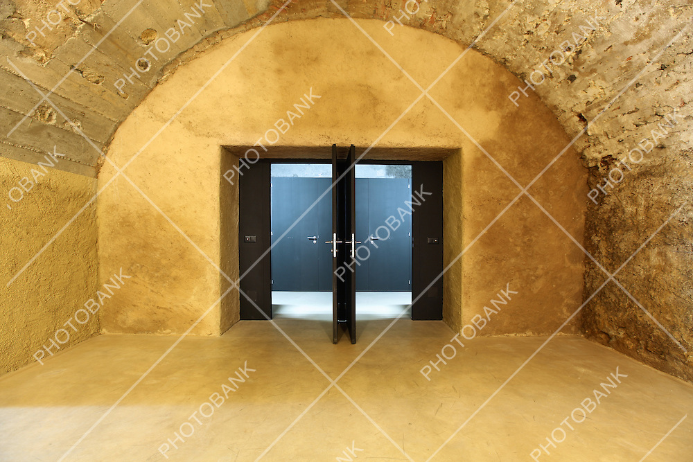 old cave in historic building, modern glass door