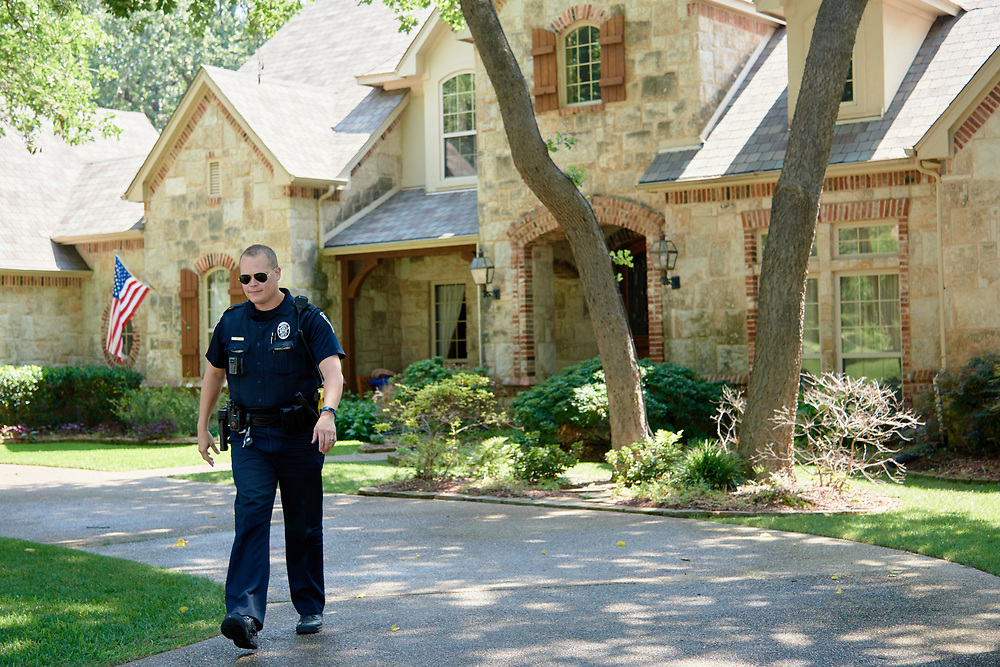 "Officer Brad Uptmore of the Southlake Police Department responds to a call in Southlake, Texas on June 23, 2017. ""CREDIT: Cooper Neill for The Wall Street Journal""<br /> Police"