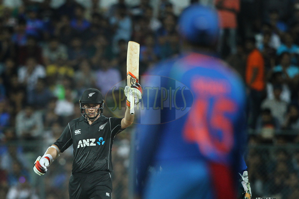 Tom Latham of New Zealand raises his bat after scoring 50 runs during the 1st One Day International match between India and New Zealand held at the Wankhede Stadium in Mumbai on the 22nd October 2017<br /> <br /> Photo by Deepak Malik / BCCI / SPORTZPICS