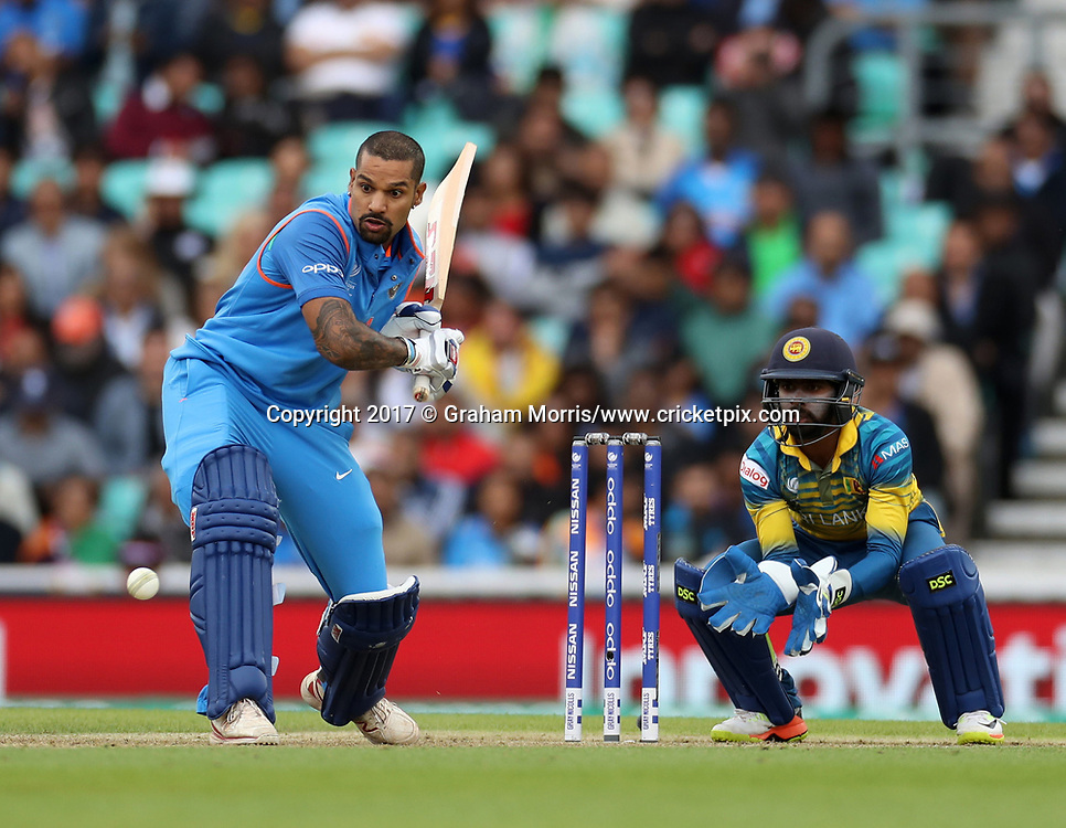 Shikhar Dhawan bats bareheaded as wicket keeper Niroshan Dickwella looks on during the Champions Trophy One Day International between India and Sri Lanka at The Oval. 8 June 2017. Photo: Graham Morris/www.cricketpix.com / www.photosport.nz