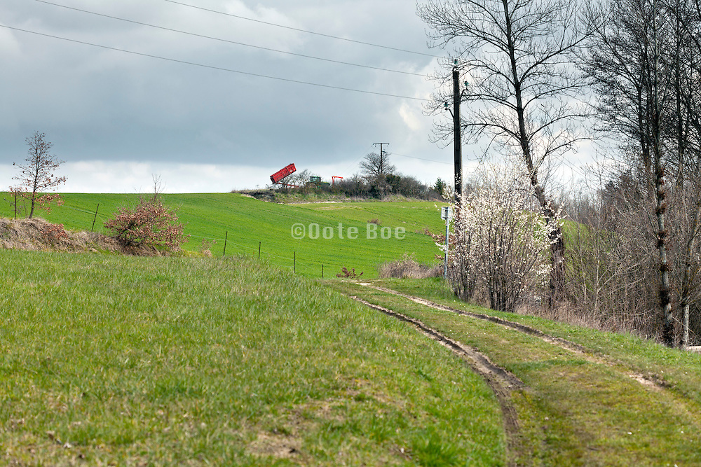rural landscape with container and tractor during spring sowing France Languedoc