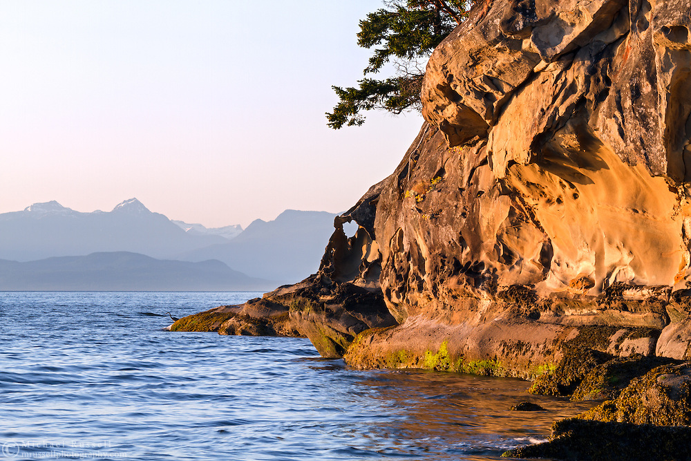 A heart shaped rock formation in the sandstone shoreline at Biggs Park in Nanaimo, British Columbia, Canada
