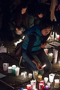 "A girl lights a candle in the ""Zocalo"" plaza after a march in favor of the 43 missing students in Guerrero state."