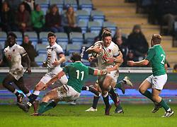 Fraser Dingwall of England U20 takes on Angus Kernohan of Ireland U20 - Mandatory by-line: Robbie Stephenson/JMP - 16/03/2018 - RUGBY - Ricoh Arena - Coventry, England - England U20 v Ireland U20 - Six Nations U20