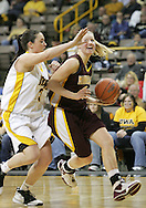 25 JANUARY 2007: Minnesota guard Emily Fox (4) tries to get around Iowa guard Abby Emmert (3) in Iowa's 80-78 overtime loss to Minnesota at Carver-Hawkeye Arena in Iowa City, Iowa on January 25, 2007.