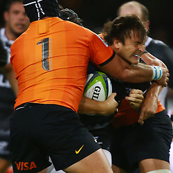 DURBAN, SOUTH AFRICA - MARCH 05: Santiago Garcia Botta of the Jaguares hits  Andre Esterhuizen of the Cell C Sharks hard and high during the 2016 Super Rugby match between Cell C Sharks and Jaguares at Growthpoint Kings Park Stadium on March 05, 2016 in Durban, South Africa. (Photo by Steve Haag/Gallo Images)