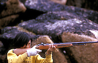 Inuit boy with riffle shooting birds on Baffin Island  North West Territories.