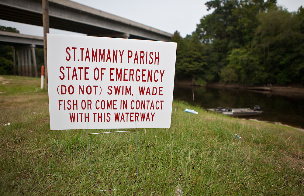 A warning sign at a boat launch next to Pearl River in St. Tammany Parish Louisiana where a fish kill caused by a spill/ discharge from the Temple-Inland paper mill in Bogalusa made up of a mixture of pulp and unspecified chemicals that turned the river black  killing fish, shellfish and turtles along 40 miles of the river. The chemicals released into the river depleted oxygen levels which caused the fish kill in the river and its' many tributaries. Clean-up crews were dispatched on the Aug. 18th to remove the dead fish before they sink depleting the waterway of more oxygen causing an even larger environmental disaster.