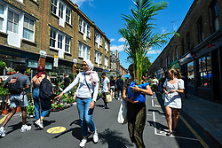 © Licensed to London News Pictures. 05/07/2020. LONDON, UK.  Plant lovers visit Columbia Road Flower Market in East London on the its reopening after certain coronavirus pandemic lockdown restrictions were relaxed by the UK government. The popular market has promoted social distancing to visitors. Photo credit: Stephen Chung/LNP
