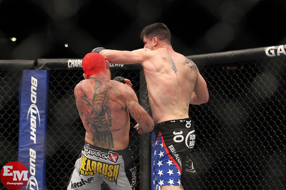 January 1, 2011; Las Vegas, NV; USA; Chris Leben (white trunks) and Brian Stann (black trunks) fight during their bout at UFC 125 at the MGM Grand Garden Arena in Las Vegas.  Stann won via knockout.