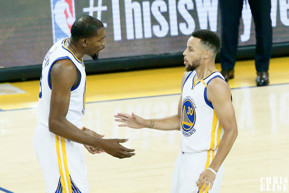 04 June 2017: Golden State Warriors forward Kevin Durant (35) and Golden State Warriors guard Stephen Curry (30) celebrate during the Golden State Warriors 132-113 victory over the Cleveland Cavaliers, in game 2 of the 2017 NBA Finals, at the Oracle Arena, Oakland, California, USA.