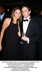CHRISTIAN ADAMS brother of Victoria Beckham and MISS LUCY LEE, at a ball in London on 11th December 2003.PPN 22