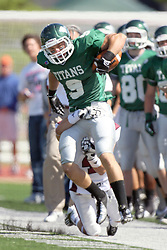 08 September 2012:  Alex Garvey hops to try and stay inbounds while running a sideline route during an NCAA division 3 football game between the Alma Scots and the Illinois Wesleyan Titans which the Titans won 53 - 7 in Tucci Stadium on Wilder Field, Bloomington IL