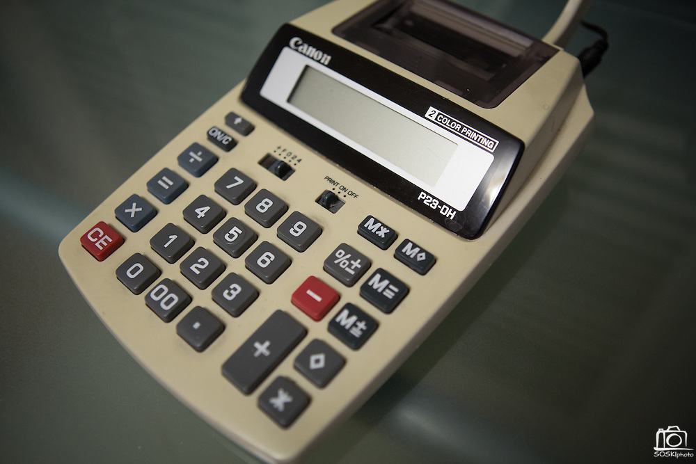 A large calculator sits atop Joy Hahn's tidy desk at her home in San Jose, California, on March 25, 2013.  Hahn is the Business Development Manager of Cornerstone Technologies and telecommutes to work several days a week. (Stan Olszewski/SOSKIphoto)