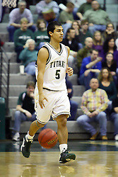 29 January 2011: Eliud Gonzalez during an NCAA basketball game between the Carthage Reds and the Illinois Wesleyan Titans at Shirk Center in Bloomington Illinois.
