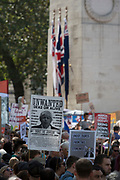 Pro-EU Remain protesters march to 'Stop the Coup' past the Cenotaph in Whitehall, near Downing Street, at the end of a week that saw Prime Minister Boris Johnson ask Queen Elizabeth for permission to suspend (prorogue) the British Parliament during the final stages of his Brexit negotiations with the European Union, in Brussels, on 31st August 2019, in Westminster, London, England.