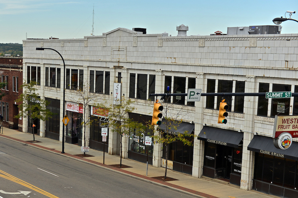 Overhead view of Odd Fellows Tattoo, A'Nival Salon and Western Fruit Basket and E Market St.