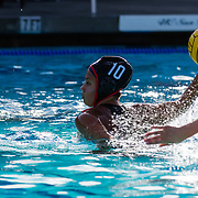 11 February 2018: The San Diego State  women's water polo team competes in day two of the Triton Invitation on the campus of UCSD. San Diego State Aztecs driver Hannah Carrillo (10) attempts a penalty shot in the third quarter. The Aztecs took on the #23 CSUN Matadors Sunday morning and came away with a 7-5 win.<br /> More game action at www.sdsuaztecphotos.com