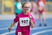 Chorzow, Poland - 2018 June 10: Special Olympics Athlete Kamila Urbanczyk runs in women's relay 4 x 100m while athtletics competition during National Special Olympics Games 2018 at Slaski Stadium on June 10, 2018 in Chorzow, Poland.<br /> <br /> Adam Nurkiewicz declares that he has no rights to the image of people at the photographs of his authorship.<br /> <br /> Picture also available in RAW (NEF) or TIFF format on special request.<br /> <br /> Any editorial, commercial or promotional use requires written permission from the author of image.<br /> <br /> Image can be used in the press when the method of use and the signature does not hurt people on the picture.<br /> <br /> Mandatory credit:<br /> Photo by &copy; Adam Nurkiewicz / Mediasport