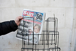 © licensed to London News Pictures. London, UK 26/02/2012. The Sun on Sunday's first edition is being placed on a stand by a newsagent in central London, this morning (26/02/12). Photo credit: Tolga Akmen/LNP