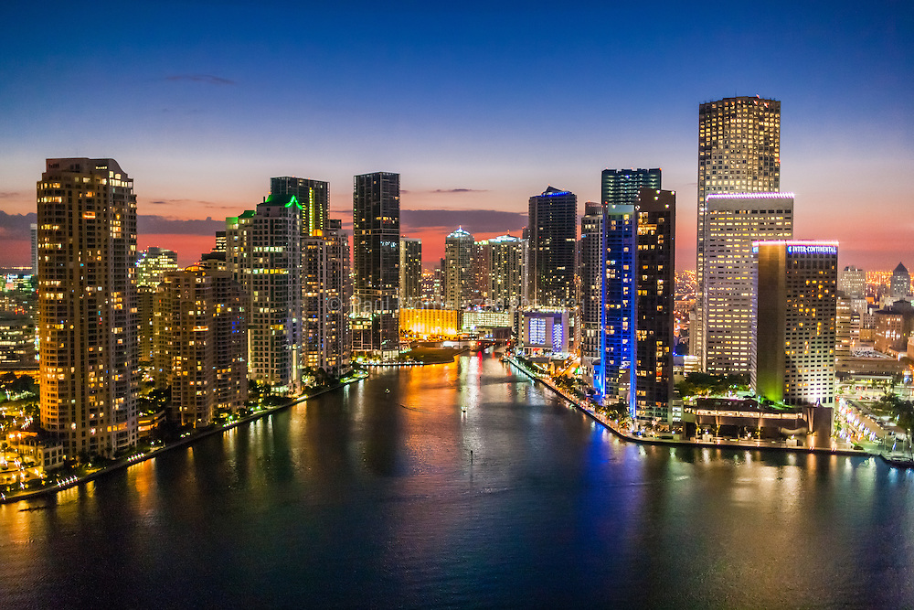 The mouth of the Miami River is framed by new condominium towers amongst the Downtown Miami skyline.