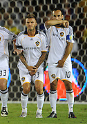 01 August 2009: Galaxy #23 David Beckham and Galaxy #10 Landon Donovan line up to block the ball for a penalty kick during an international friendly soccer match between FC Barcelona and the Los Angeles Galaxy at the Rose Bowl in Pasadena, CA.