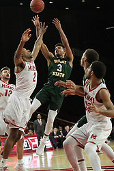 November 14, 2017 - Oxford, Ohio, U.S - Wright State Raiders guard Mark Hughes (3) puts up a shot over Miami (Oh) Redhawks forward Rod Mills Jr. (2). During play in Overtime on Tue Nov 14 2017 as the Redhawks in 73 to 67. (Credit Image: © Ernest Coleman via ZUMA Wire)