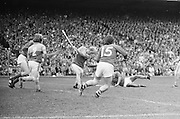 Wexford makes a swing at the slitor sending it flying up field during the All Ireland Senior Hurling Final, Cork v Wexford in Croke Park on the 5th September 1976. Cork 2-21, Wexford 4-11.