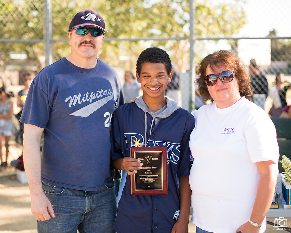 Mark and Maria De Jesus present Mondesi Abair, 13, center, with the Michael De Jesus award to recognize his hard work and dedication to baseball during Little League closing ceremonies at the Milpitas Sports Center on June 13, 2013. (Stan Olszewski/SOSKIphoto)