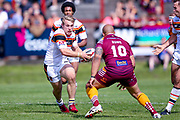 Bradford Bulls hooker Sam Hallas (29) takes the ball into the challenge with Batley Bulldogs Alex Rowe (10)  during the Kingstone Press Championship match between Batley Bulldogs and Bradford Bulls at the Fox's Biscuits Stadium, Batley, United Kingdom on 16 July 2017. Photo by Simon Davies.