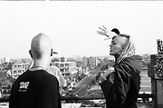 Conversations on the rooftop, looking out at Bristol's cityscape, 1990s.