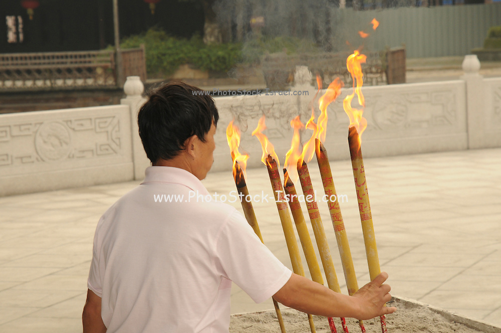 China, Zhejiang Province, Wuzhen Burning essence in a temple