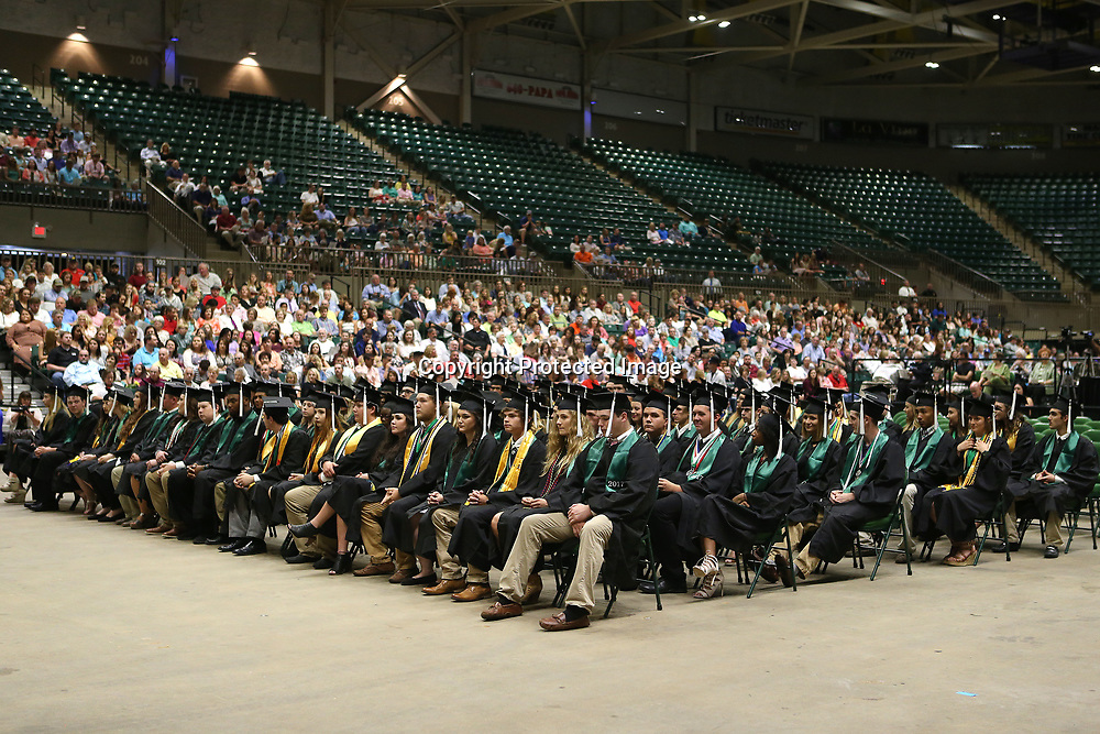 Mooreville High School seniors listen to the speakers during Mooreville's graduation ceremony Saturday afternoon at the BancorpSouth Arena.