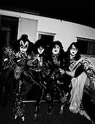 Photo of Gene Simmons, Paul Stanley, Spaceman and Catman from the band Kiss backstage in Rome - 1980