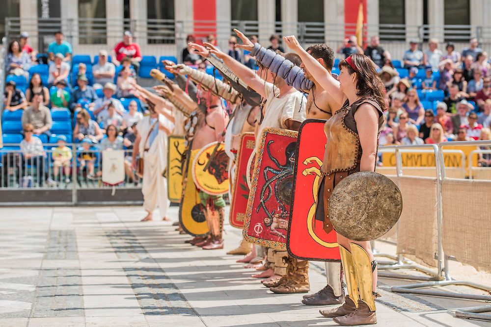 Gladiators arrive and salute the crowd and the Emporeron the site of London's only performers that worked on Ridley Scott's Gladiator film will clash on the spot where gladiators battled 2,000 years ago in the courtyard of the Guildhall. Ten public evening and matinee performances will take place on selected dates between 8 and 16 August. Full information and tickets at www.museumoflondon.org.uk<br /> <br /> <br /> Hidden for centuries, the ancient remains of London's Roman amphitheatre were discovered by archaeologists in 1988. They are open for viewing all year. The Gladiator Games are performed by Britannia, renowned for its work on the Ridley Scott film, Gladiator. Each performance is the result of research into events in the 1st century A.D., using images drawn from Roman coins, paintings, sculpture and mosaics.