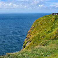 Peak Elevation of the Cliffs of Moher near Liscannor, Ireland <br /> Aillte an Mhothair is the Irish name for this stunning seascape.  The namesake for this geological beauty is a 1st century B.C. fort built on the southern end called either Moher Uí Ruis or Moher Uí Ruidhin. These mean ruined fort.  The stronghold was leveled by the British towards the end of the 18th century.  From that position atop Hag's Head, the cliffs begin their dramatic accent from 390 feet until reaching their peak elevation of 702 feet near O'Brien's Tower shown here.